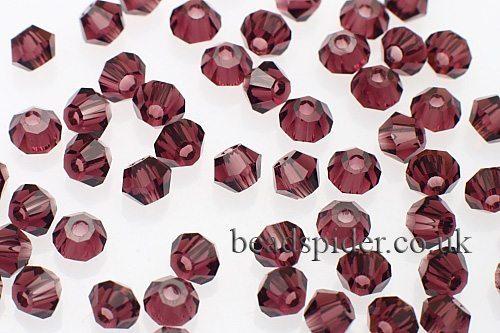 CBI615 Deep Amethyst Bi-cone  x 25