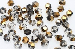 CBI537 Crystal Old Gold Bi-cone  x 30