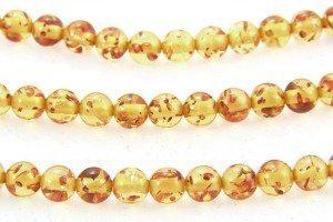 6mm Round Yellow/Honey Copal Amber.