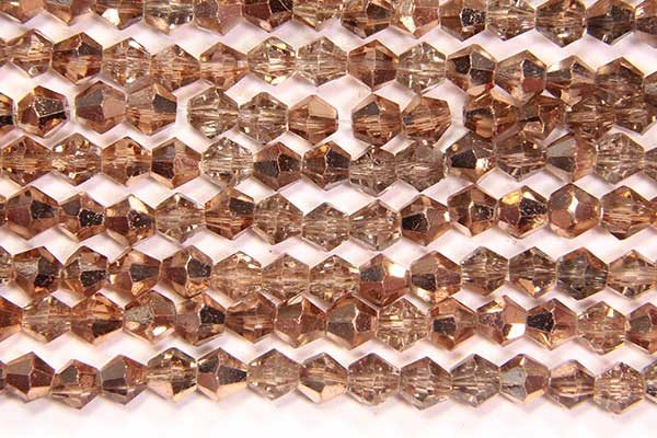 Demi Coated Light Gold Crystal Bicones